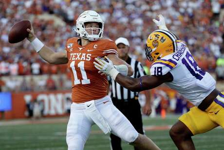 Texas quarterback Sam Ehlinger (11) is pressured by LSU linebacker K'Lavon Chaisson (18) during the first half of an NCAA college football game, Saturday, Sept. 7, 2019, in Austin, Texas. (AP Photo/Eric Gay)
