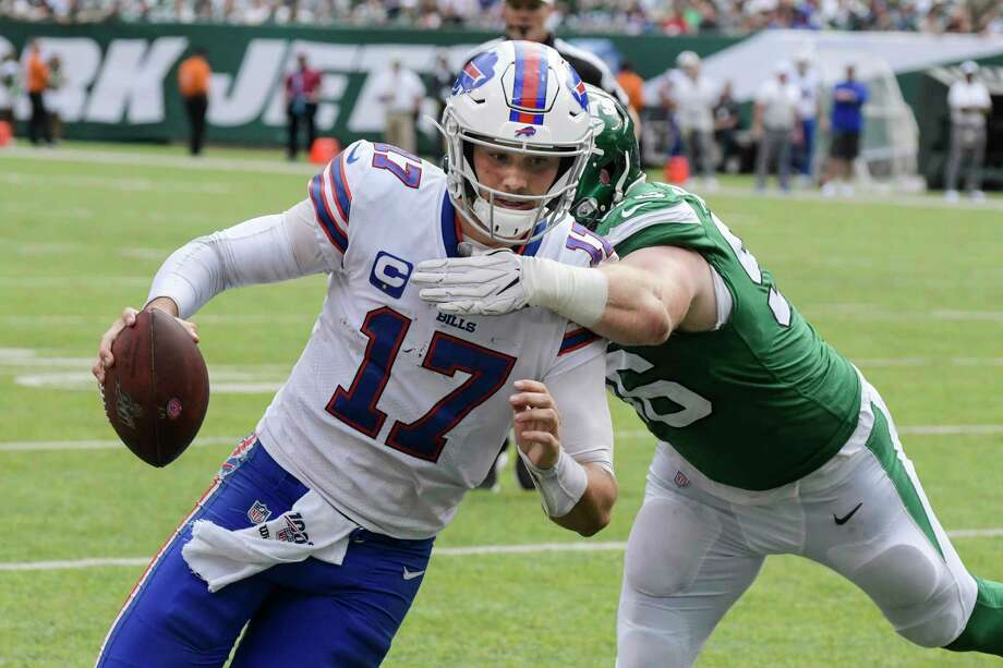 Buffalo Bills' Josh Allen (17) runs past New York Jets' Henry Anderson (96) for a touchdown during the second half of an NFL football game Sunday, Sept. 8, 2019, in East Rutherford, N.J. (AP Photo/Bill Kostroun) Photo: Bill Kostroun / Copyright 2019 The Associated Press. All rights reserved