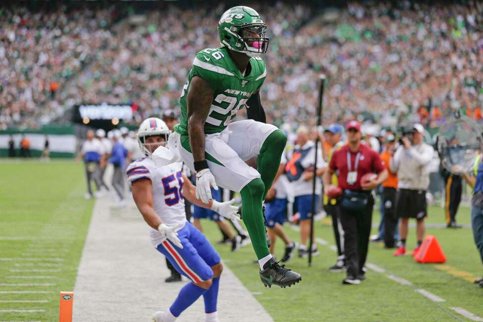 New York Jets running back Le'Veon Bell (26) celebrates after running past Buffalo Bills' Matt Milano (58) for a touchdown during the second half of an NFL football game Sunday, Sept. 8, 2019, in East Rutherford, N.J. (AP Photo/Seth Wenig)