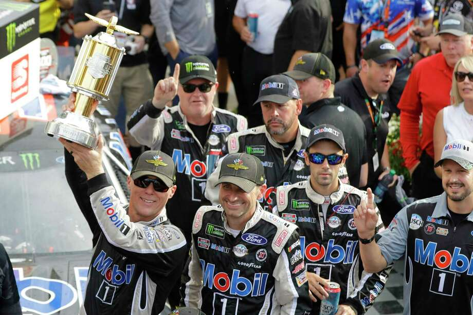 Kevin Harvick, left, celebrates after winning the NASCAR Brickyard 400 auto race at Indianapolis Motor Speedway, Sunday, Sept. 8, 2019, in Indianapolis. (AP Photo/Darron Cummings) Photo: Darron Cummings / Copyright 2019 The Associated Press. All rights reserved.