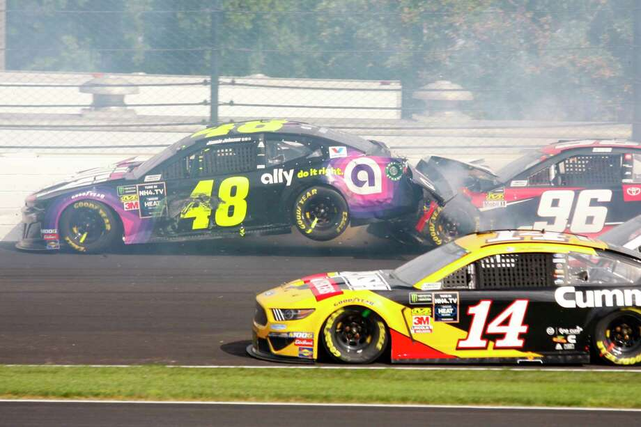 NASCAR driver Jimmie Johnson (48) is hit by Parker Kligerman (96) in the second turn during the NASCAR Brickyard 400 auto race at the Indianapolis Motor Speedway, Sunday, Sept. 8, 2019, in Indianapolis. (AP Photo/Mike Fair) Photo: Mike Fair / Copyright 2019 The Associated Press. All rights reserved.