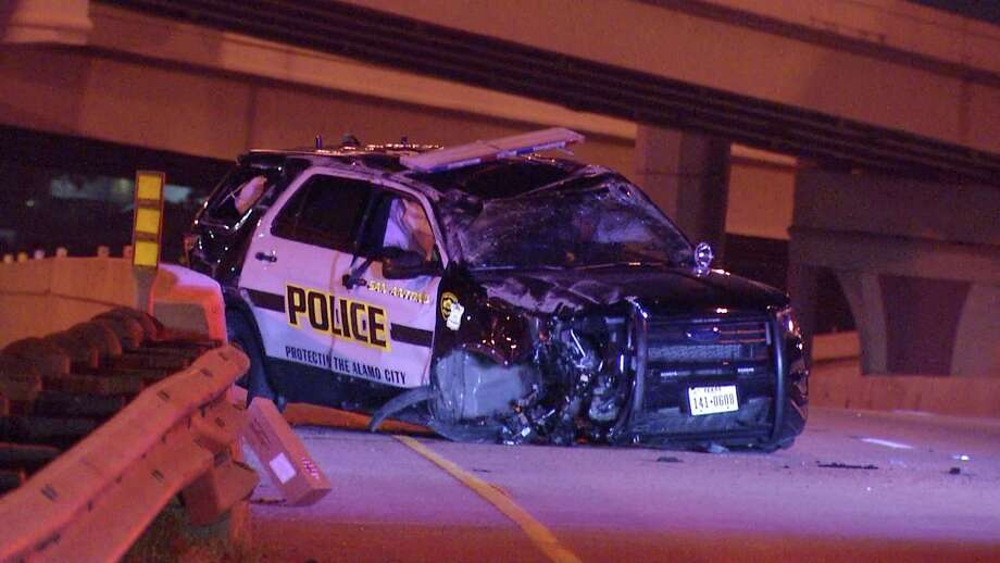 A San Antonio police officer is in the hospital after he rolled his vehicle over while searching for someone driving the wrong way, according to police reports. Photo: Ken Branca