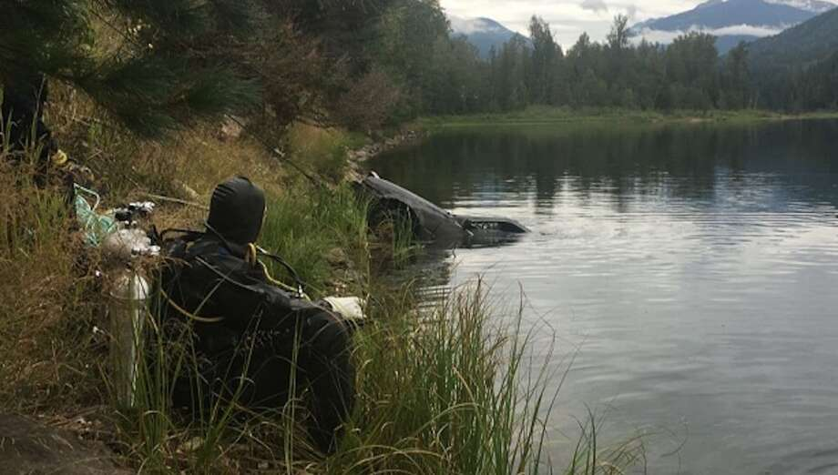 A Honda Accord is pulled out of the water at Griffin Lake in British Columbia on Aug. 24. Photo: Royal Canadian Mounted Police