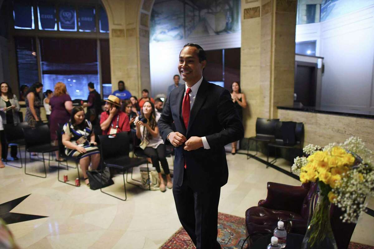 Democratic presidential hopeful Julian Castro smile after speaking to journalists from the lobby of the San Antonio Express-News on Thursday, Sept. 5, 2019.