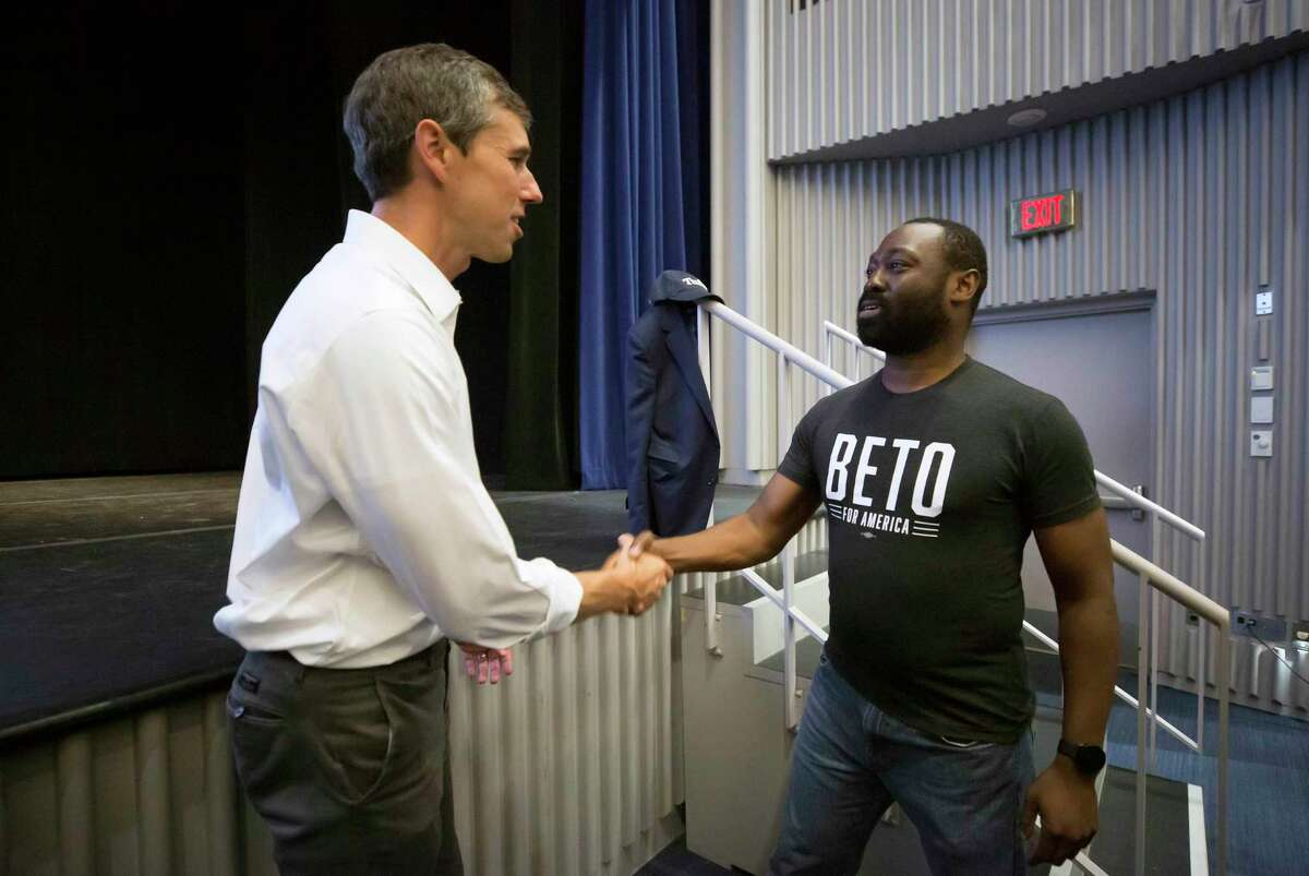 Democratic presidential candidate former Texas Rep. Beto O'Rourke greets an audience member after a Town Hall event at Tufts University Thursday, Sept. 5, 2019, in Medford, Mass. (AP Photo/Winslow Townson)