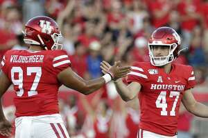 Houston long snapper Nick Wildberger (97) and place kicker Dalton Witherspoon (47) celebrate Witherspoons field goal during the first half of an NCAA college football game against Prairie View A&M Saturday, Sept. 7, 2019, in Houston, Texas.