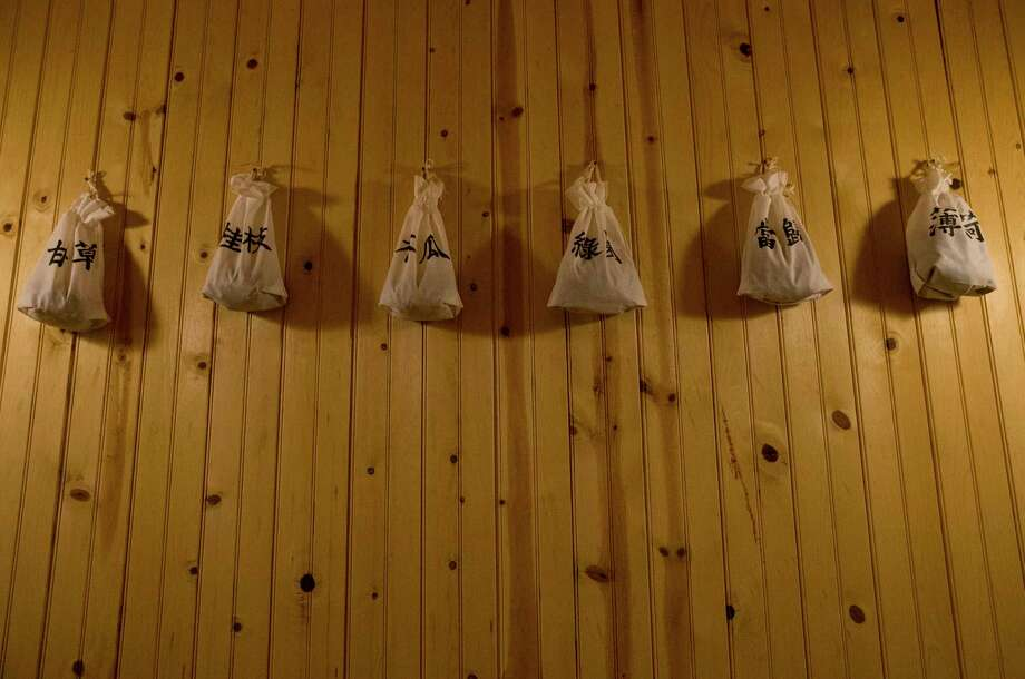 The herbs that are used at the dry sauna at the 24/7 Korean-style Gangnam Spa are hung on the wall. Besides the shower and sauna, the spa provides Topaz Cave, Himalayan Salt Room, traditional Korean Bul Ga Ma, Igloo Ice Room, Relaxation Lounge, Hot and Cold Foot Spa, nail shop and massage. Photo: Yi-Chin Lee,  Staff / Staff Photographer / © 2019 Houston Chronicle