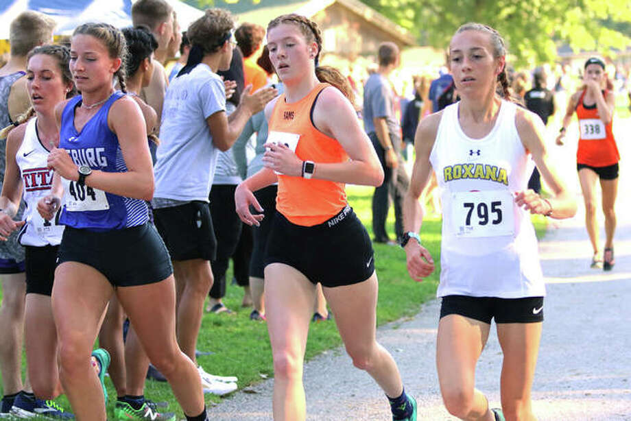 Roxana's Janelynn Wirth (right) runs with Mount Vernon's Summer Chelf (second right), Freeburg's Breanna Chandler (second left) and Chatham Glenwood's Jade Anderson midway through the three-mile run at the Granite City Invitational on Saturday at Wilson Park in Granite City. Wirth finished fifth, Chandler sixth, Chelf 13th and Anderson 14th in the race with 179 girls. Photo: Greg Shashack / The Telegraph