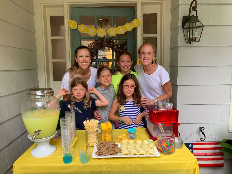 Caroline and Catherine Geis, along with Claris and Vivian Flannery, set up their stand on Knollwood Lane for two hours on Labor Day. They charged a few quarters for lemonade and snow cones, and ended up raising a total of $162. Photo: Darien Nature Center