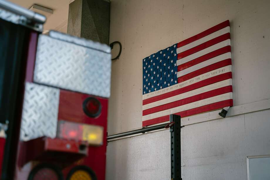 An American flag hangs on the wall inside of the the Castle Rock Fire Station in Tracy on June 17. Photo: Sarahbeth Maney / Special To The Chronicle