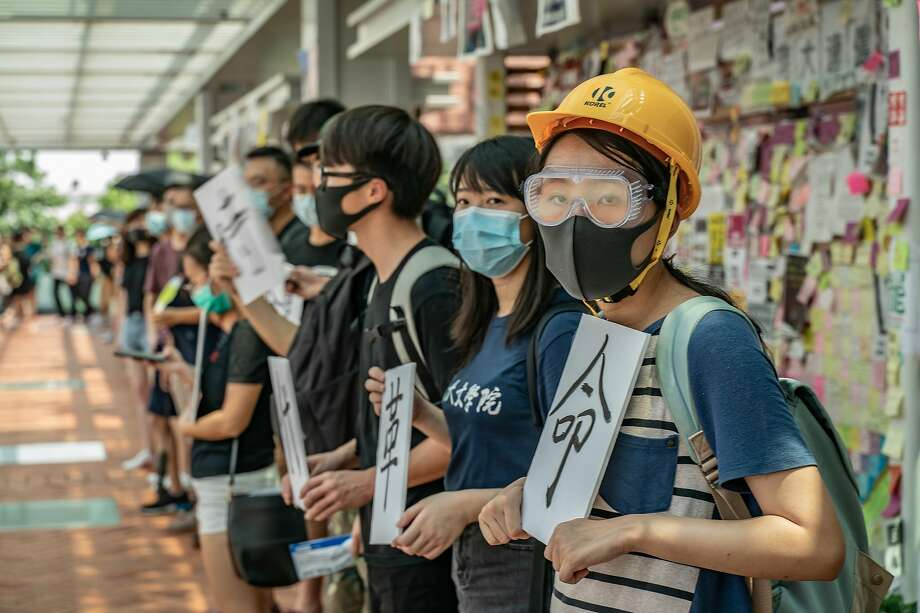 HONG KONG, CHINA - SEPTEMBER 9 : Students holds placards as they take part in the Occupy University Street rally at the University of Hong Kong on September 9, 2019 in Hong Kong, China. Pro-democracy protesters have continued demonstrations across Hong Kong despite the withdrawal of a controversial extradition bill as demonstrators call for the city's Chief Executive Carrie Lam to immediately meet the rest of their demands, including an independent inquiry into police brutality, the retraction of the word Riot to describe the rallies, and the right for Hong Kong people to vote for their own leaders. (Photo by Anthony Kwan/Getty Images) Photo: Anthony Kwan / Getty Images