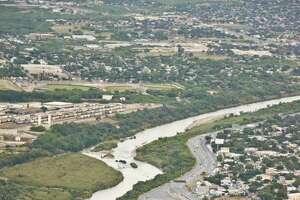 An aerial view Juarez-Lincoln International Bridge, Gateway to the Americas International Bridge, the Rio Grande and Mexico, right, as seen on April, 10, 2014.