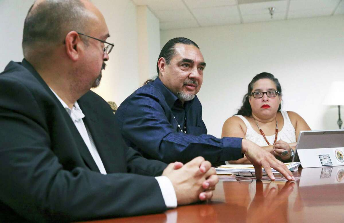 Ramón J. Vasquez, center, discusses his views as leaders of the Tap Pilam Coahuiltecan Nation meet with the Express-News Editorial Board on Aug. 15, 2019. On the left is Art Martinez de Vara, the group's tribal counsel. On the right is Karla Aguilar, development coordinator with Tap Pilam's nonprofit entity, American Indians in Texas at the Spanish Colonial Missions. A lawsuit filed by the Tap Pilam says sacred remains at the Alamo are not being adequately protected in an ongoing state project.