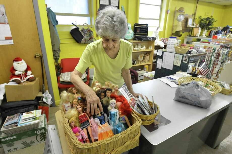 Angie Toski straightens the basket of Barbie Dolls while working the the St. Thomas The Apostle Thrift Shop, Second Chance on Wednesday August 10, 2017 in Norwalk Conn. The church's annual tag sale will be held Saturday, Sept. 14 and Sunday, Sept. 15. Photo: Alex Von Kleydorff / Hearst Connecticut Media / Norwalk Hour