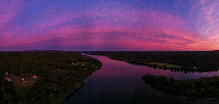 """Haddam Neck photographer Neal Perron captured this purple Hurricane Dorian sunset over the Connecticut River Thursday evening with his drone. """"Experts say that the strange purple skies are the result of light from the sun being scattered in a particular way by hurricane storm clouds,"""" Perron said. Photo: Contributed Photo / Neal Perron Photography"""