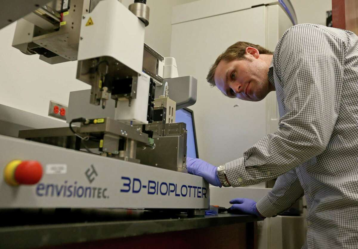 University of Texas at San Antonio officials said the College of Engineering and College of Business will offer the joint master of science degree program in biomedical technology commercialization, beginning in the spring 2020 semester. In this 2016 photo, UTSA biomedical engineering doctoral student Joseph Pearson calibrates the EnvisionTEC 3D-Bioplotter before printing a small 3D silicone jaw bone on the UTSA campus in this 2016 photo.