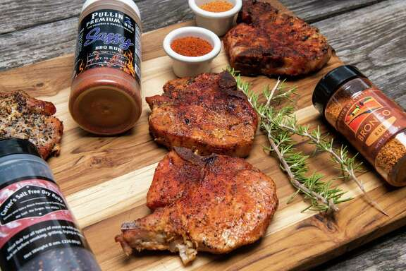 Some of the top seasonings made by San Antonio area businesses for pork include, from left, Carter's Salt Free Dry Rubs, Sassy BBQ Rub (made by Pullin Premium BBQ), and Broncos Rub (made by Deep River Specialty Foods).