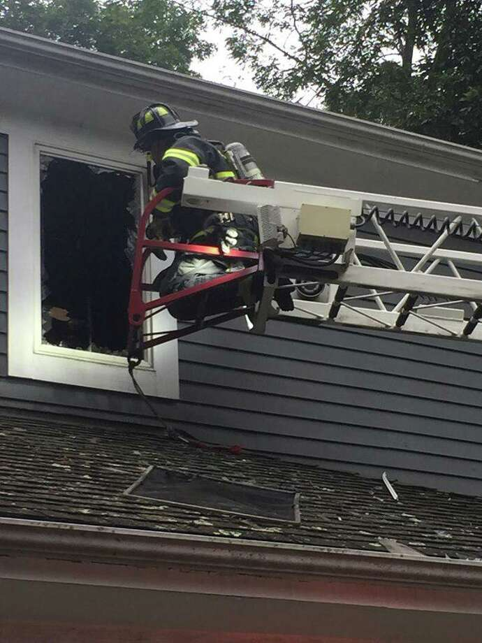 A Greenwich firefighter works on a house fire in Glenville. Photo: / Greenwich Professional Firefighters