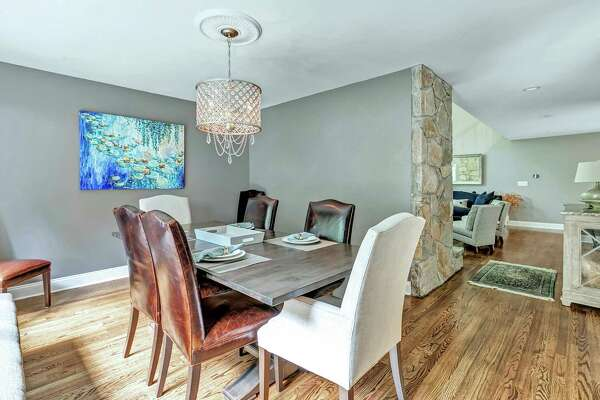 The dining room can be accessed from the living room and kitchen.