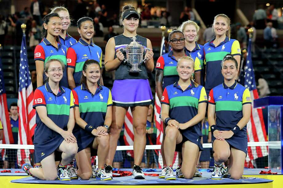 Bianca Andreescu of Canada celebrates with the championship trophy alongside ball people after winning the Women's Singles final against against Serena Williams at the 2019 US Open on Sept. 7 Photo: Elsa / Getty Images / 2019 Getty Images
