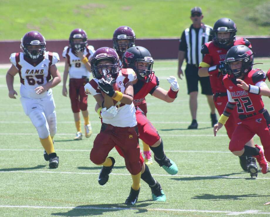 Hugo Gonzalez scampers for one of his double-digit runs in the first half Saturday afternoon, getting dragged down at the Falcons' six-yard line. He scored on the next play. Photo: Robert Avery