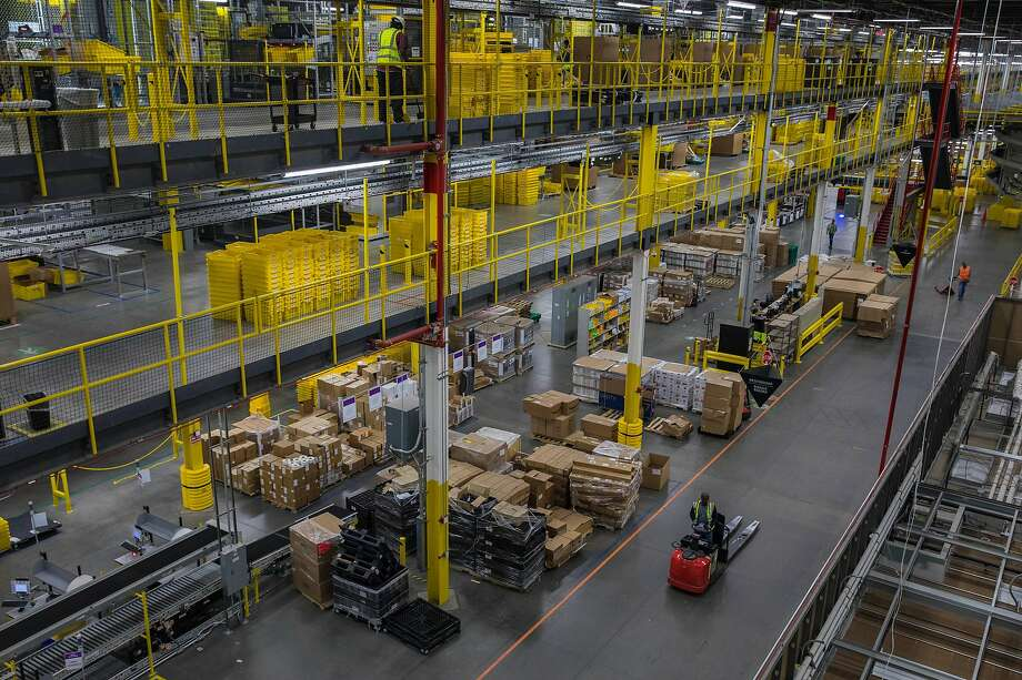 Amazon has many facilities like this one in New York. Some regulators worry its site favors its products. Photo: Hiroko Masuike / New York Times