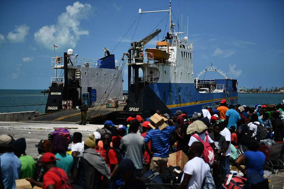 People wait to board a ship Saturday for evacuation to Nassau, Bahamas, from Marsh Harbor Abaco Island. Hurricane Dorian struck the islands as a fearsome Category 5 storm. Photo: BRENDAN SMIALOWSKI;Brendan Smialowski / AFP / Getty Images
