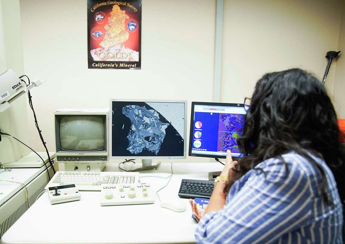 Monica Martinez, an undergraduate at UH, talks about finding a mineral in the lunar soil that has never been found before in a lab on Thursday, Sept. 5, 2019 in Houston.