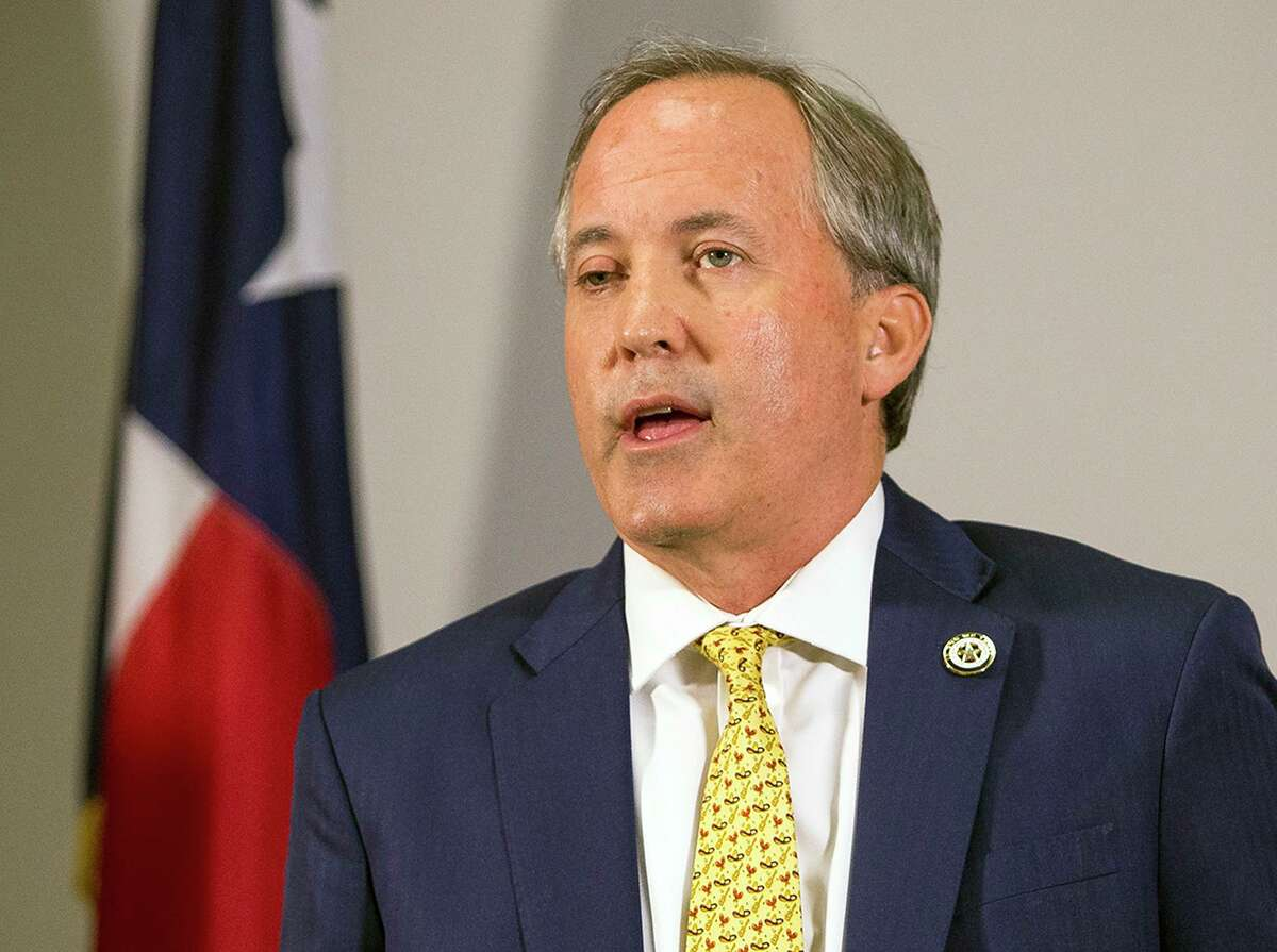 Texas Attorney General Ken Paxton speaks at a news conference in Austin in May.