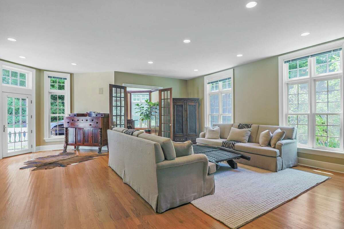 The spacious family room has a door to the patio and yard.