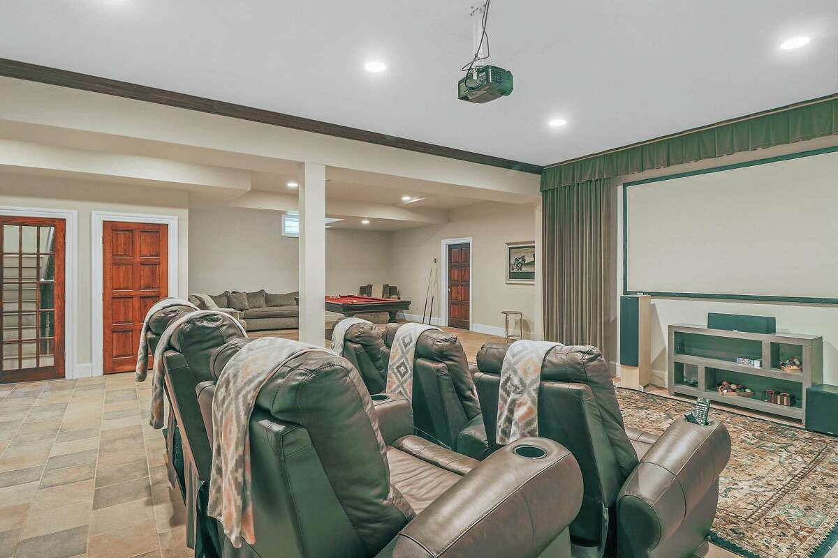 There is a six-seat home theater on the lower level.