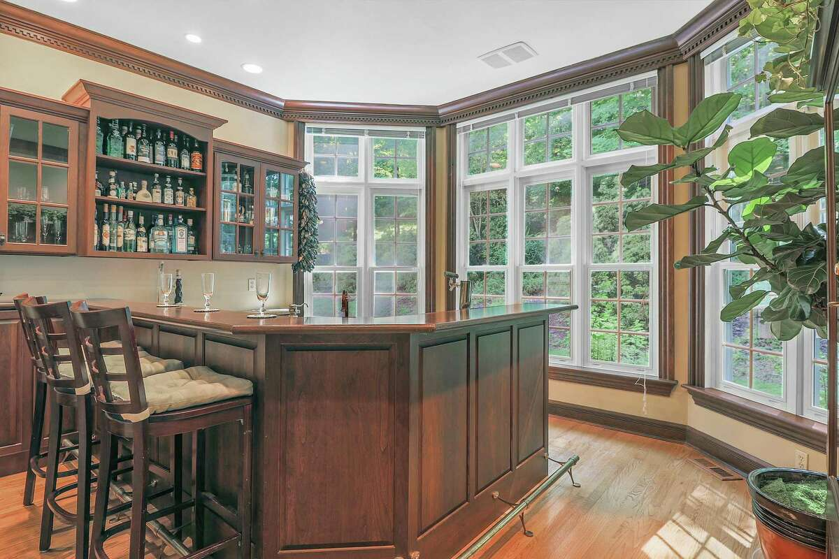 The 10-room house features an authentic pub or tap room with a brass foot rail, keg and bar stool seating, and a custom ventilation system for cigar smoking.