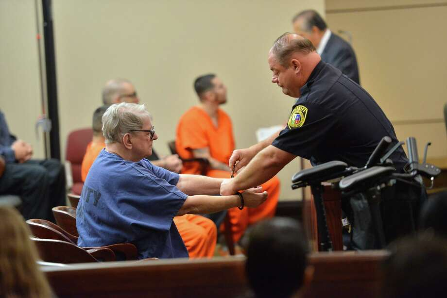 Convicted baby killer Genene Jones is handcuffed as she arrives for a hearing Monday morning in the 399th state District Court. Jones, a former pediatric nurse, was convicted in 1984 of fatally injecting Chelsea McClellan of Kerrville with a powerful medication. After her attorney withdrew his motion for a competency trial MOnday, the judge decided that Jones will stand trial on additional murder charges in February. Photo: Robin Jerstad /Contributor