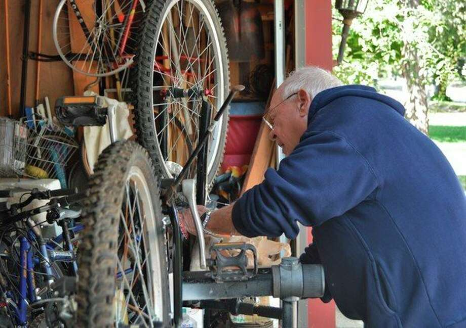 Midland resident and retiree Ed Hannum cleans a bicycle in his garage on Sept. 5, 2019. Hannum cleans, fixes and restores all varieties of bikes to sell and donate to the community. (Ashley Schafer/Ashley.Scahfer@hearstnp.com)