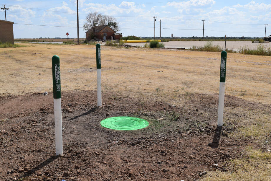 A coat of lime green paint marks the lid and three short marked indicator poles surround the manhole in which a teen fell 20 feet on Sept. 7. Photo: Ellysa Harris/Plainview Herald