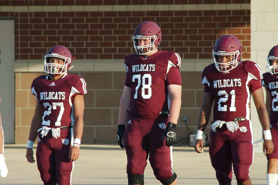 Clear Creek's Chad Lindberg (78) walks out with teammates Rayfield Conley (27) and Daqari Tuckson (21) before a game against Deer Park Friday, Sept. 6 at Challenger Columbia Stadium. Photo: Kirk Sides / Staff Photographer / © 2019 Kirk Sides / Houston Chronicle