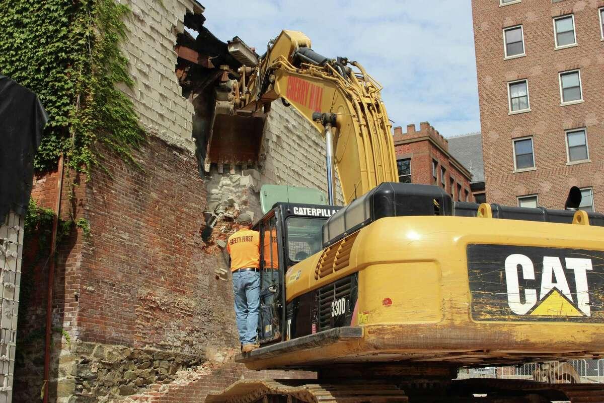 Demolition of a pair of buildings has begun at 157 and 171 Golden Hill Street in Bridgeport.