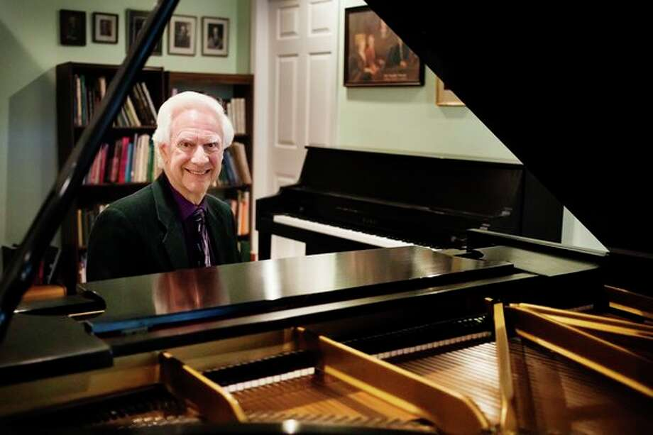Midland musician George Fee poses for a portrait Monday in his home studio. A series of eight lecture concerts by Fee begins Sunday and continues each month at St. John's Episcopal Church in Midland. (Katy Kildee/kkildee@mdn.net)