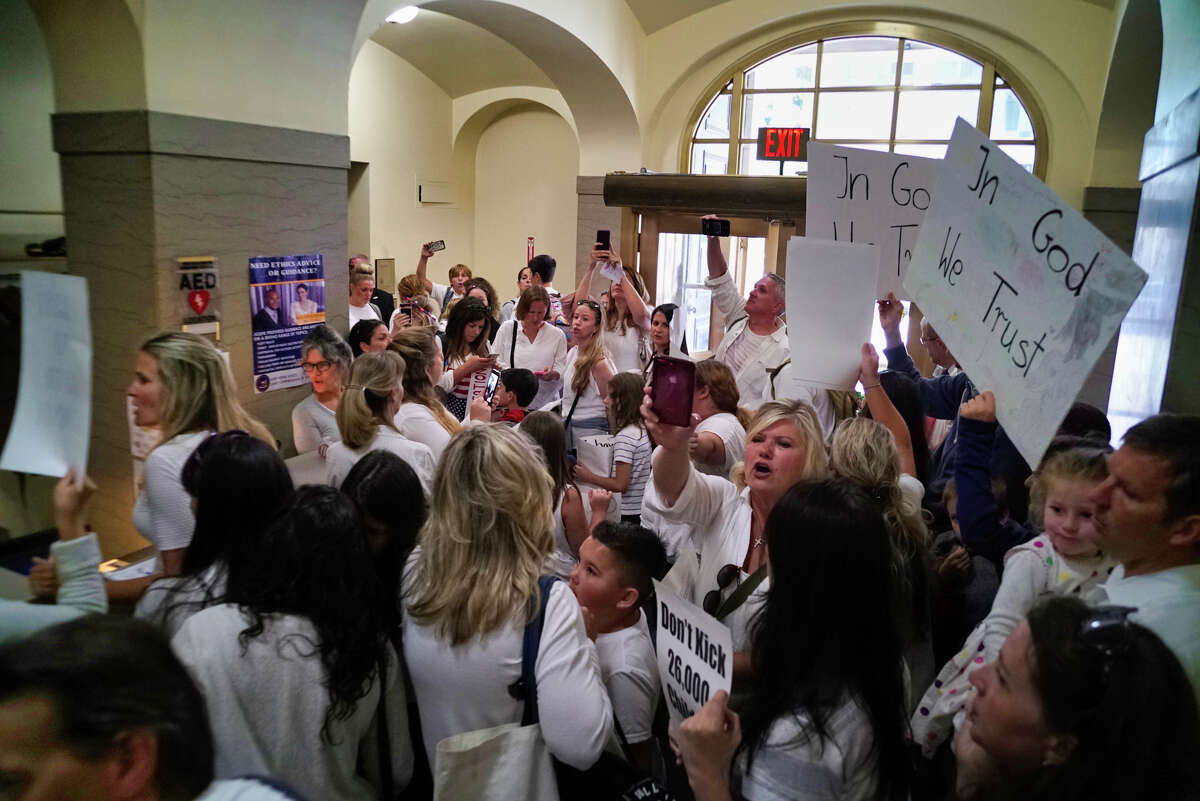 Hundreds of families opposed to vaccinating their children fill the hallway in the New York State Education building as they protest just outside the Board of Regents meeting on Monday, Sept. 9, 2019, in Albany, N.Y. Families came to Albany to pressure the board to delay the implementation of a law that ends religious exemptions to New York school vaccination requirements. (Paul Buckowski/Times Union)