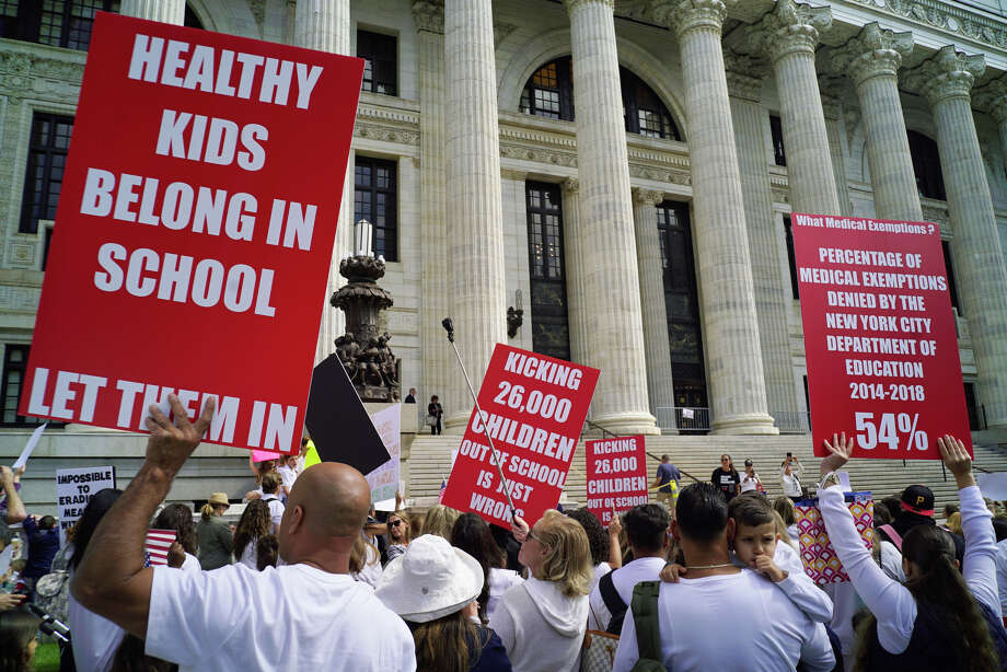 Hundreds of families opposed to vaccinating their children hold a rally on the steps of the New York State Education building on Monday, Sept. 9, 2019, in Albany, N.Y. Families came to Albany to pressure the Board of Regents to delay the implementation of a law that ends religious exemptions to New York school vaccination requirements.  (Paul Buckowski/Times) Photo: Paul Buckowski, Albany Times Union / (Paul Buckowski/Times Union)