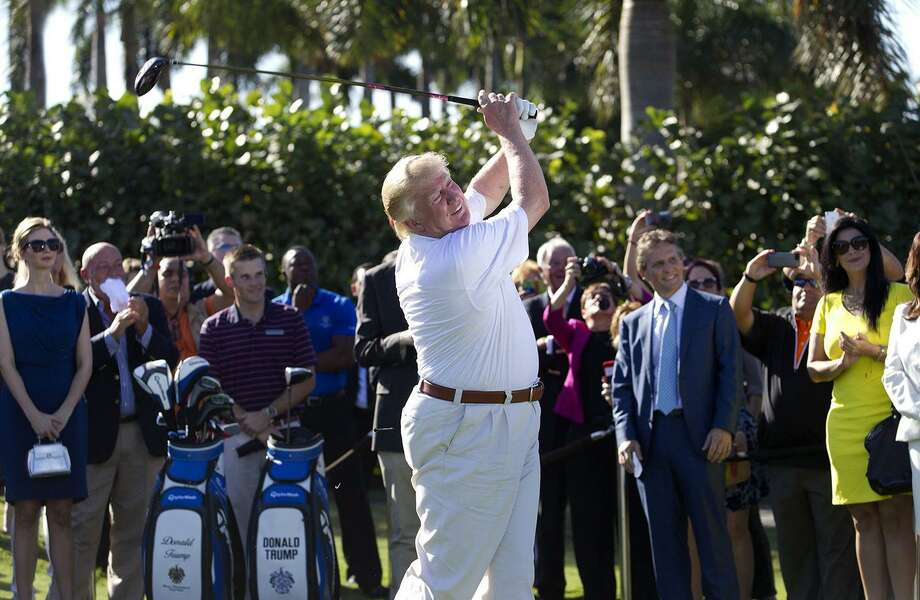 Donald Trump in 2014 takes a ceremonial tee shot off the first tee at Trump National Doral in Florida. As president, though, a reader says he he has been no stranger to the links. A reader thinks he should spend less time golfing. Photo: David Walters /TNS / Miami Herald