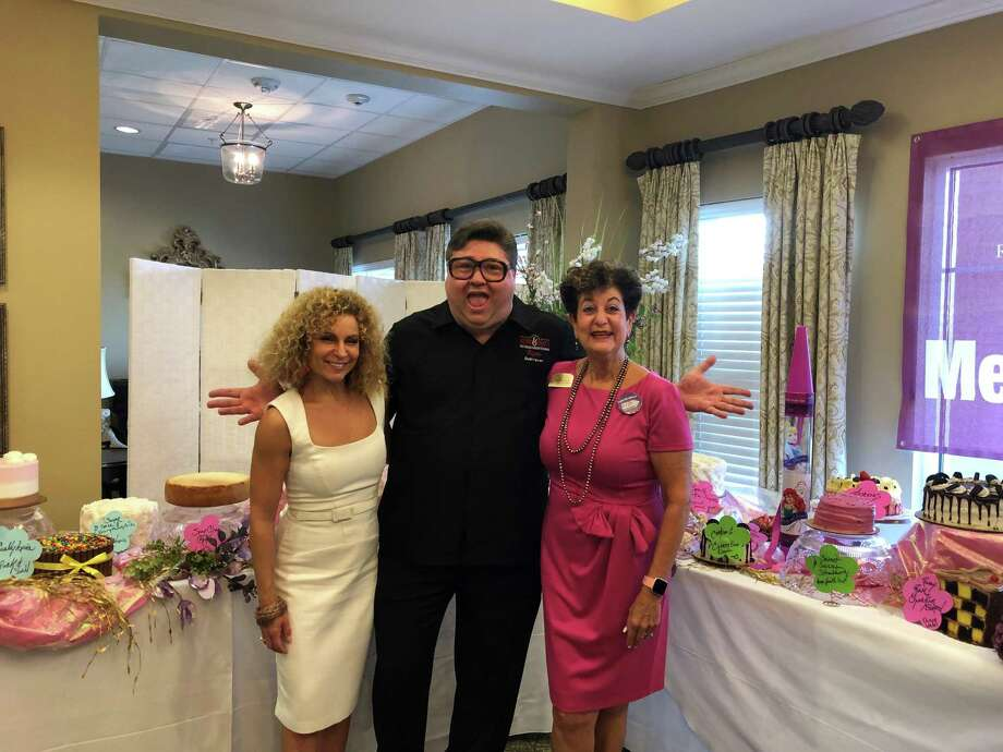 At a cake auction held at The Village of Meyerland on Thursday, Sept. 5, Director of Business Development Marci Walters (pictured left), Kenny & Ziggy's Owner Ziggy Gruber and Director of Sales and Marketing Jane Shapiro celebrate the approximately $2,700 raised for the Alzheimer's Association. Photo: Courtesy By The Village Of Meyerland
