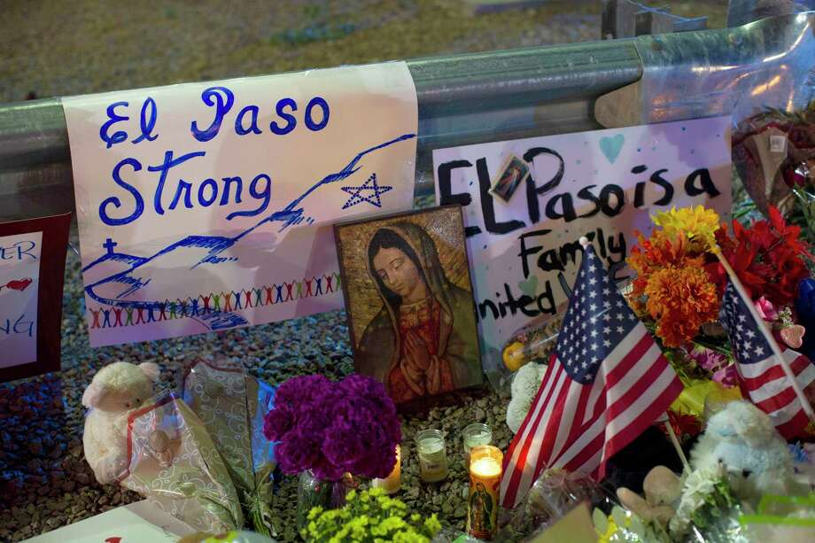 A Virgin Mary painting, flags and flowers adorn a makeshift memorial Aug. 4 for the victims of the mass shooting at a Walmart in El Paso, Texas. On Sept. 3 Walmart announced it is discontinuing the sale of ammunition for handguns and short-barrel rifles and asking customers to not openly carry firearms in the stores, even in state's where it's allowed. Photo: Andres Leighton / Associated Press / FR171260 AP