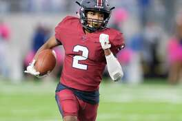 Taurean Muhammad (2) of the Tompkins Falcons runs around the right end in the first half against the Taylor Mustangs in a high school football game on Thursday, October 25, 2018 at Legacy Stadium in Katy Texas.
