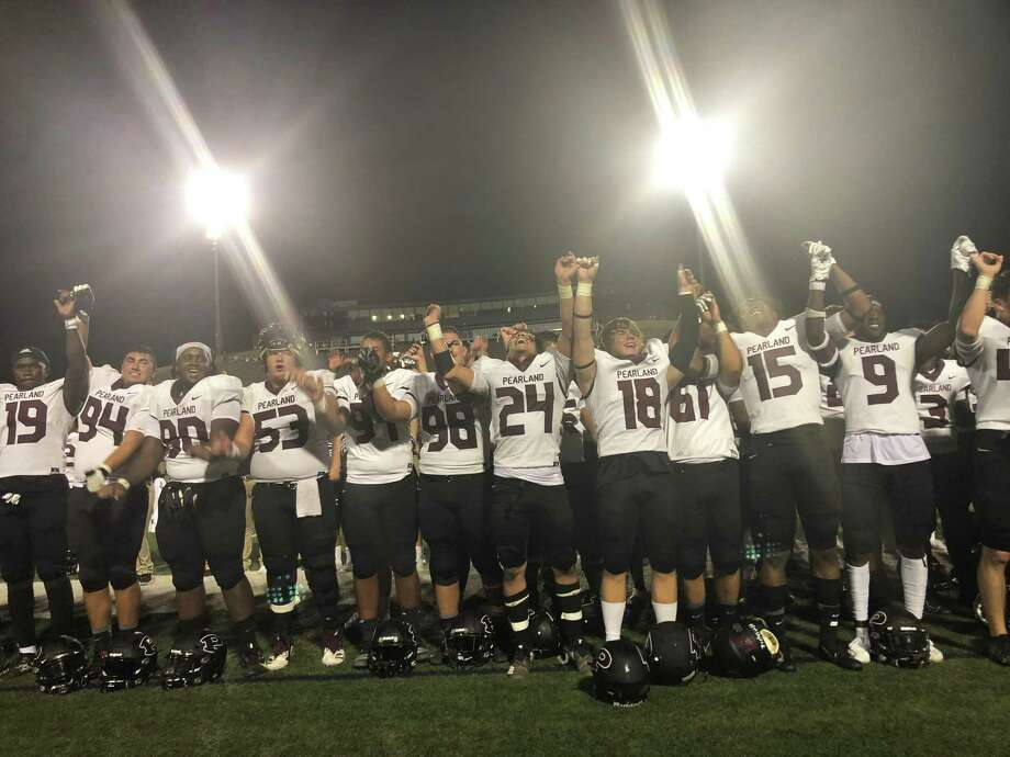 The Pearland players sing the school song in front of their fans after beating Memorial 49-23 on Sept. 7 at Spring Branch ISD's Tully Stadium Photo: Elliott Lapin / Staff Photo