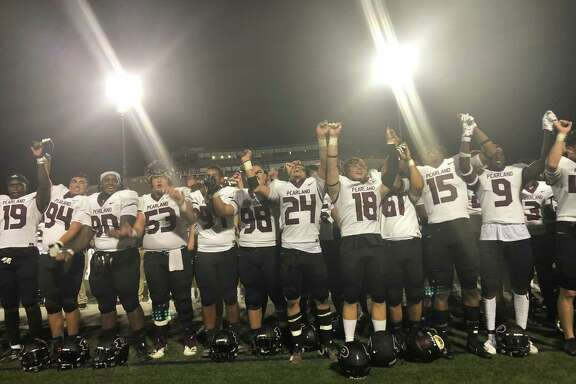 The Pearland players sing the school song in front of their fans after beating Memorial 49-23 on Sept. 7 at Spring Branch ISD's Tully Stadium