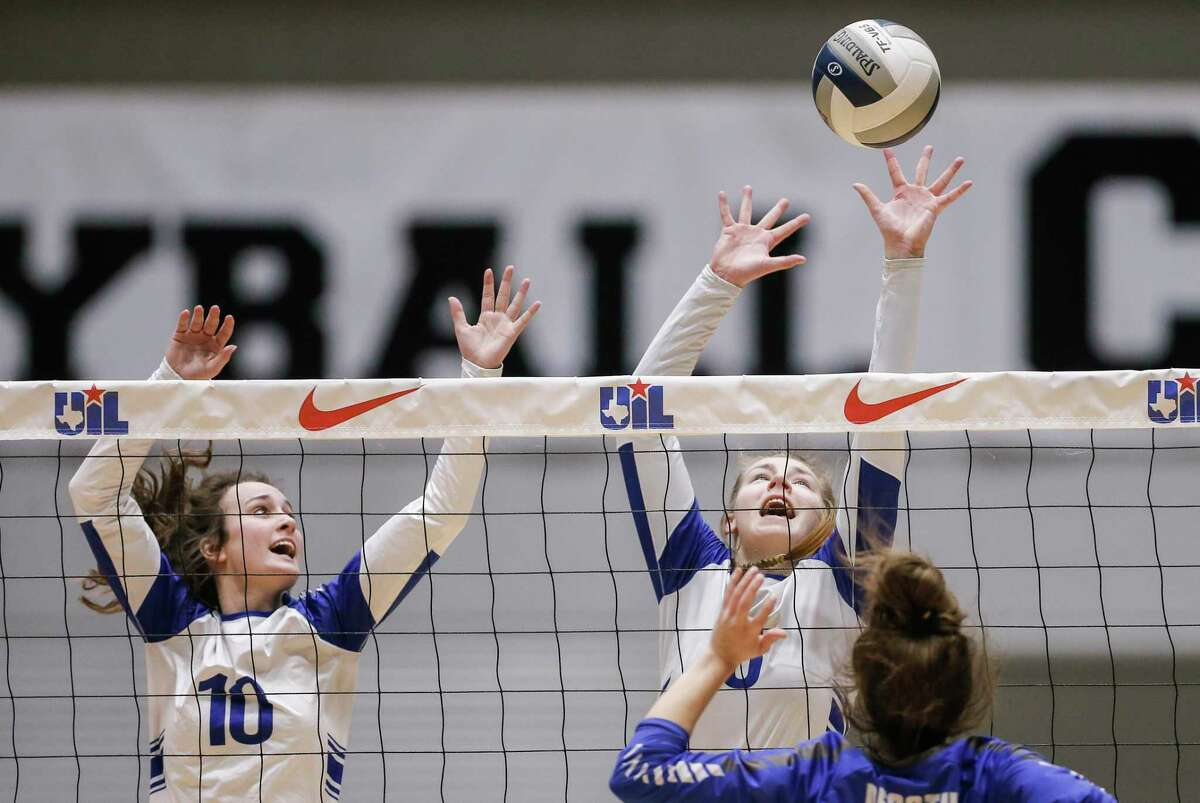 Needville sophomore Maddy Hrncir (10) and senior Madison Schultz (8) attempt to block a spike from Decatur sophomore Makenna Gantt (18) during a Class 4A State Championship volleyball game at the Curtis Culwell Center in Garland, Texas, Saturday, November 17, 2018. Special to the Houston Chronicle/Brandon Wade.