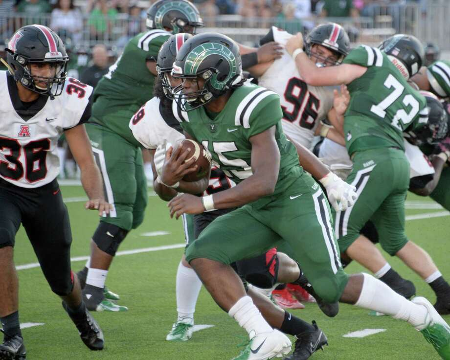 Julius Loughridge (15) of Mayde Creek carries the ball in the first quarter of a non-district football game between the Mayde Creek Rams and the Ft. Bend Austin Bulldogs on Saturday, September 7, 2019 at Legacy Stadium, Katy, TX. Photo: Craig Moseley, Houston Chronicle / Staff Photographer / ©2019 Houston Chronicle
