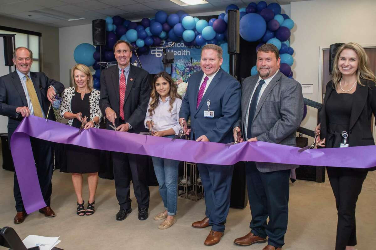 Encompass Health Corp. held a Sept.4 grand opening celebration for its new, freestanding rehabilitation hospital in Katy. Ribbon-cutting participants, from left, are: Frank Brown, president of Encompass Health's southwest region; Barb Jacobsmeyer, EVP and president of inpatient hospitals; Congressman Pete Olson; former Encompass Health patient Steffany Quintana; Nick Hardin, Encompass Health Katy CEO; Joey Matthews, Hoar Construction project superintendent; and Elizabeth Mann, director of design and construction for Encompass Health.