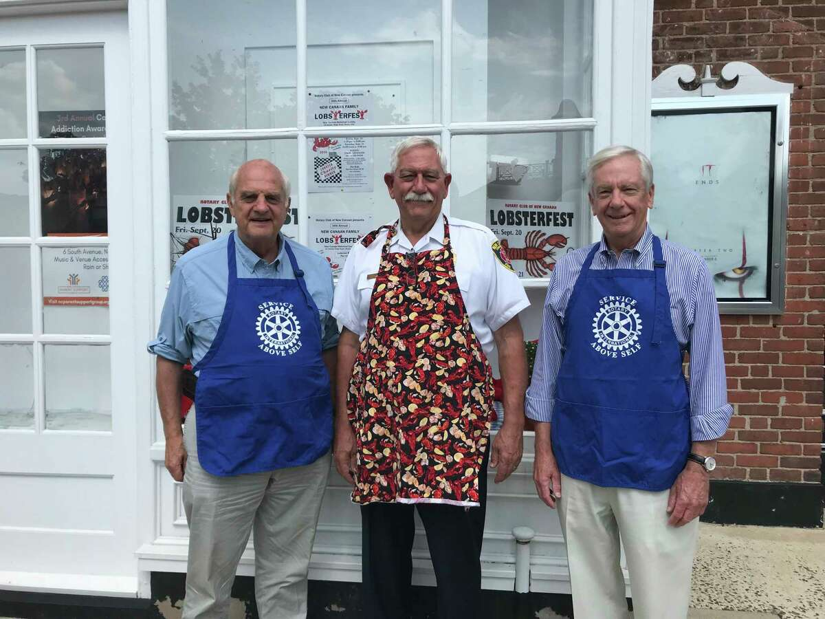 Rotary Club of New Canaan Lobsterfest Committee members Keith Simpson, Fred Baker and Scott Cluett, promote the Sept. 20-21 event at a display at the New Canaan Playhouse.